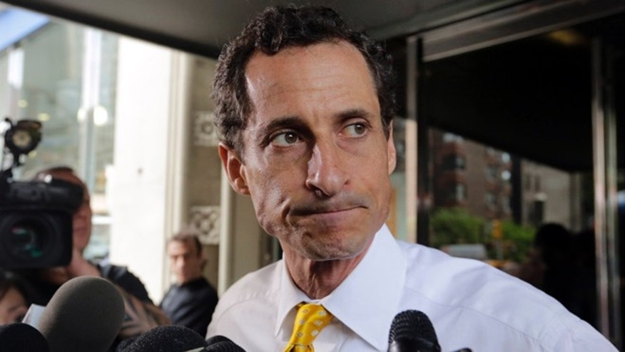 New York City mayoral candidate Anthony Weiner leaves his apartment building in New York.
