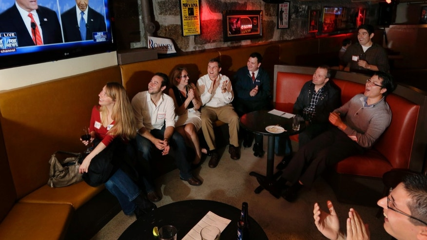 FILE - In this Oct. 3, 2012 file photo members of the Massachusetts GOP Young Republicans react as they watch the first presidential debate between President Barack Obama and Republican Mitt Romney in Boston. Republicans lost the popular vote for the fifth time in the last six presidential elections with the latest loss due in large measure to Obamaâs advantage over Romney among younger and non-white voters. Young party leaders say Republicans aiming to reach beyond the partyâs white, aging core need to do more than just retool campaign strategy and tactics. They also need GOP elected officials to offer concrete policies to counter Democratic initiatives. (AP Photo/Elise Amendola, File)