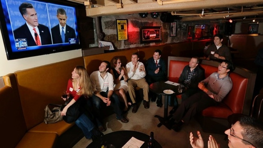 FILE: Oct. 3, 2012:  Members of the Massachusetts GOP Young Republicans watch the first presidential debate between President Obama and Republican Mitt Romney in Boston, Mass.