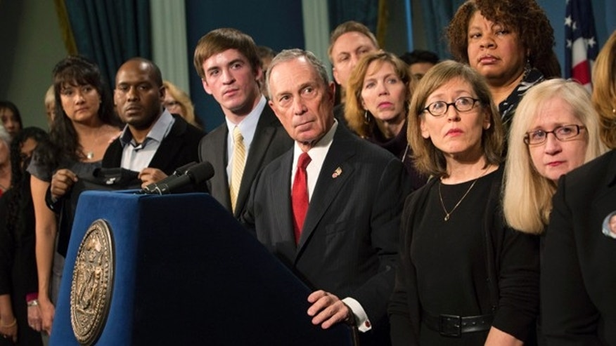 Dec. 17, 2012: New York City Mayor Michael Bloomberg (C), along with survivors and family members of gun violence victims, addresses the media as part of the Mayors Against Illegal Guns group.