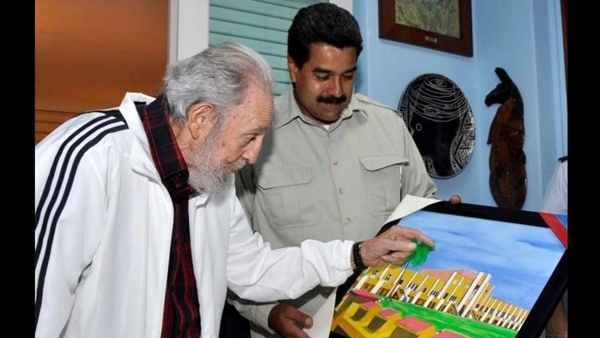 Venezuela's President Nicolas Maduro with Cuba's former President Fidel Castro during their meeting at Havana, Cuba, on Saturday, July 27, 2013.
