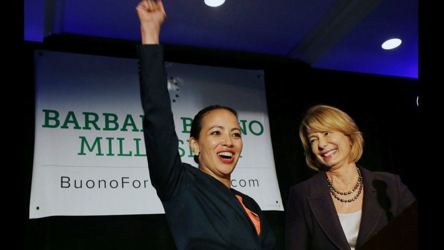 Labor leader Milly Silva reacts Monday, July 29, 2013, in East Rutherford, N.J., as she is introduced as Democratic gubernatorial candidate Barbara Buono's, right, nominee for lieutenant governor. The 43-year-old Montclair resident and executive vice president of a private union of health care workers, wasted no time attacking Republican Gov. Chris Christie, whose policies she says have hurt the middle- and working-class. The all-female ticket is a first for New Jersey and only the third nationwide. (AP Photo/Mel Evans)