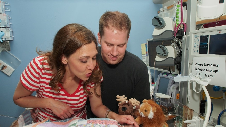 U.S. Rep. Jaime Herrera Beutler, Herrera Beutler, left, is seen with her husband, Dan Beutler, and their baby, Abigail Rose Beutler, on July 23, 2013, at Lucile Packard Childrenâs Hospital in Palo Alto, Calif.