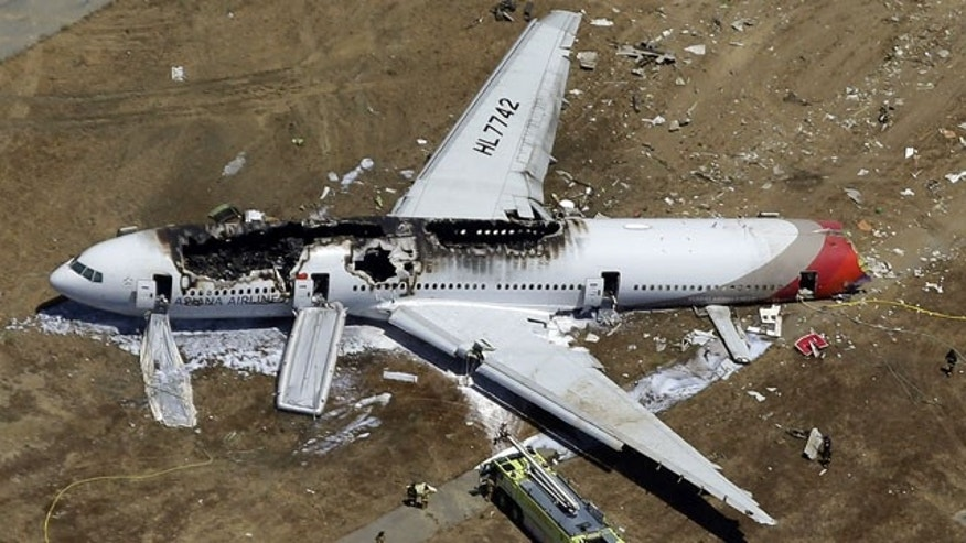 In this July 6, 2013 aerial file photo, the wreckage of Asiana Flight 214 lies on the ground after it crashed at the San Francisco International Airport, in San Francisco. The Federal Aviation Administration is advising all foreign airlines to use a GPS system instead of visual approaches when landing at San Francisco International Airport in the wake of the deadly Asiana Airlines crash. Pilots on Asiana Airlines Flight 214 had been cleared to make a visual approach when the plane crash-landed on a runway at the San Francisco airport July 6. (AP Photo)