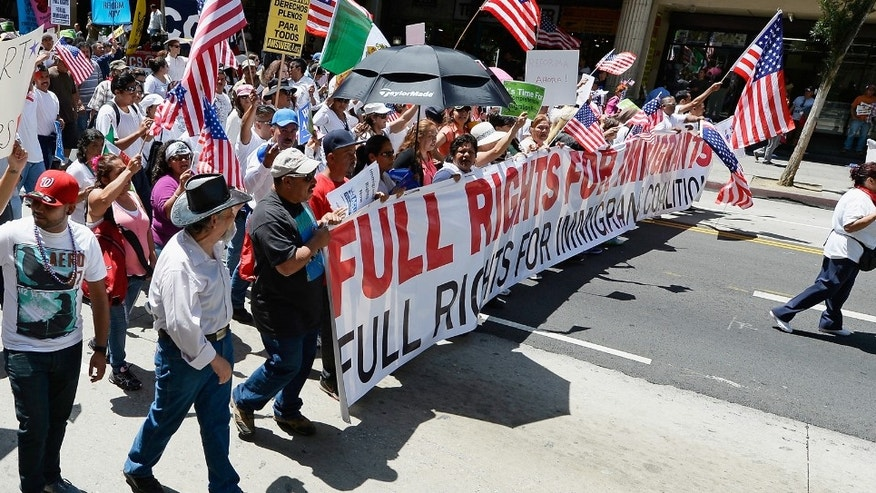 LOS ANGELES, CA - MAY 01:  Celebrants participate in the May Day march and rally on May 1, 2013 in Los Angeles, California. Labor organizations and immigration groups used the annual celebration to push for an immigration system overhaul.  (Photo by Kevork Djansezian/Getty Images)