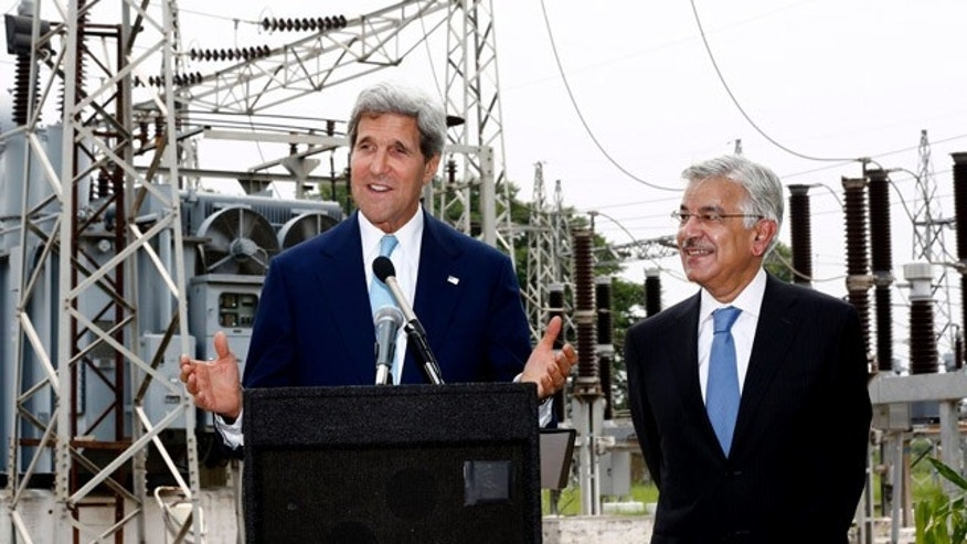 Aug. 1, 2013: U.S. Secretary of State John Kerry, left, speaks alongside Pakistan's Petroleum Minister Khawaja Mohammed Asif during their visit to an electric supply company substation in Islamabad, Pakistan.