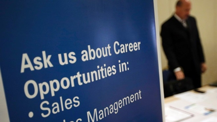 A recruiter waits to meet with job seekers at a career fair, in King of Prussia, Pa.