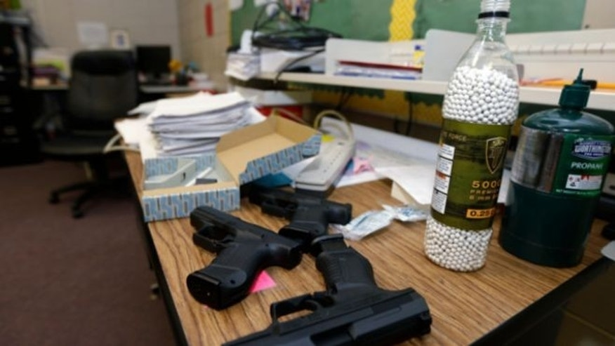 July 11, 2013: Practice air-powered handguns sit on a teacher's desk in a classroom at Clarksville High School in Clarksville, Ark.