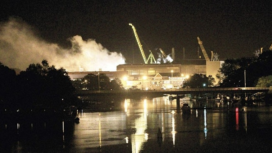 FILE: May 23, 2012: Smoke rises from a dry dock as fire crews respond to a fire on the USS Miami SSN 755 submarine at the Portsmouth Naval Shipyard on an island in Kittery, Maine.