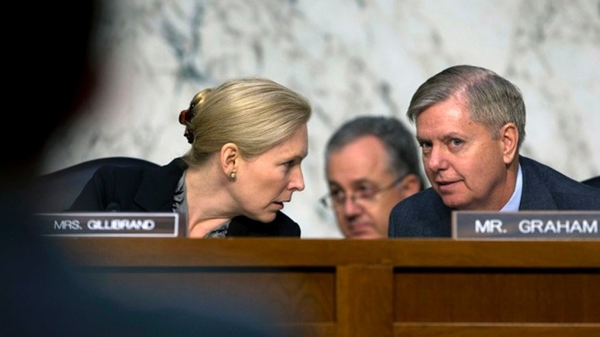 In this March 13, 2013, file photo the Chair of the Senate Subcommittee on Personnel, Sen. Kirsten Gillibrand, D-N.Y., left, talks with the subcommittee's ranking Republican, Sen. Lindsey Graham, R-S.C.