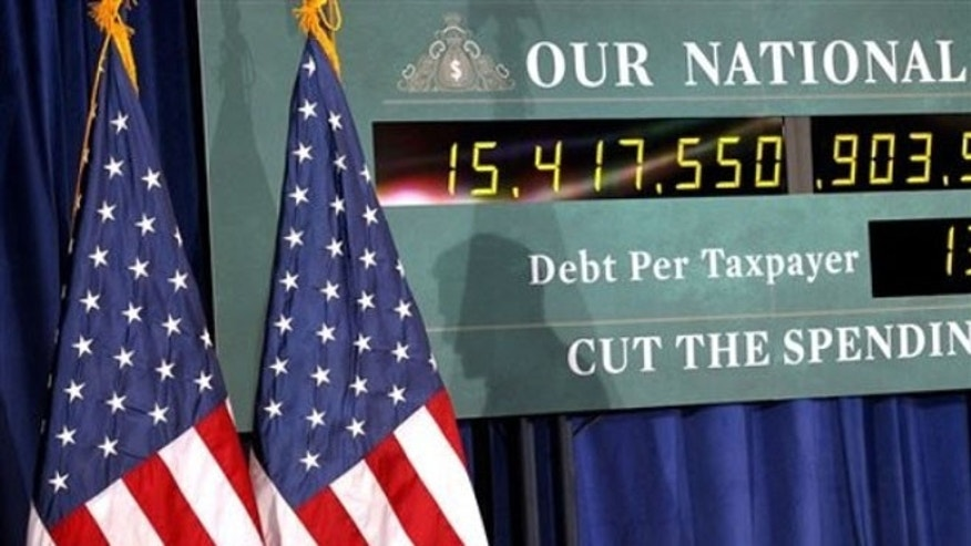 Feb. 24, 2012: A national debt clock is shown during a campaign event for Mitt Romney in Kalamazoo, Mich.