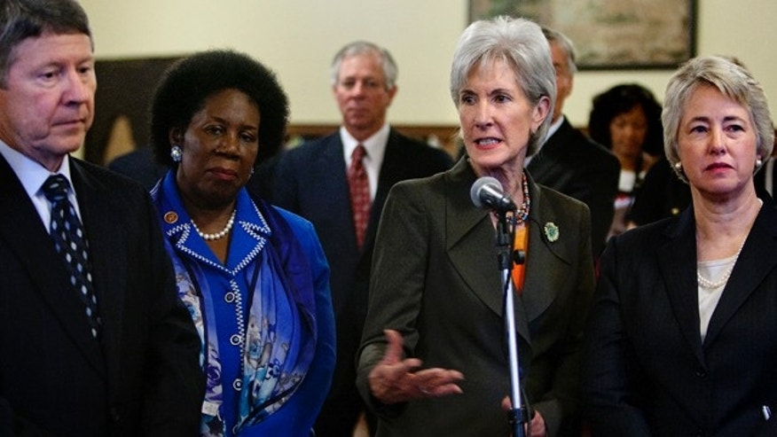 Aug. 19, 2013: County Judge Ed Emmett, left, Congresswoman Sheila Jackson Lee, center left, and Mayor Annise Parker, right, look on as Secretary of Health and Human Services, Kathleen Sebelius, center, addresses attendees during a stakeholder meeting to address implementation of the Affordable Care Act in Houston.