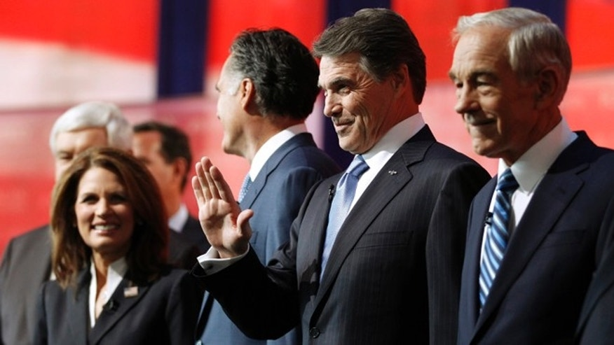 Sept. 7, 2011: Republican presidential candidates stand on stage before a presidential primary debate at the Ronald Reagan Presidential Library in Simi Valley, Calif.