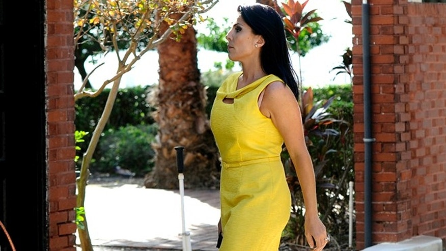 Nov. 12, 2012: Jill Kelley, a friend of the Petraeus family, walks out of her home toward her car in Tampa, Fla.
