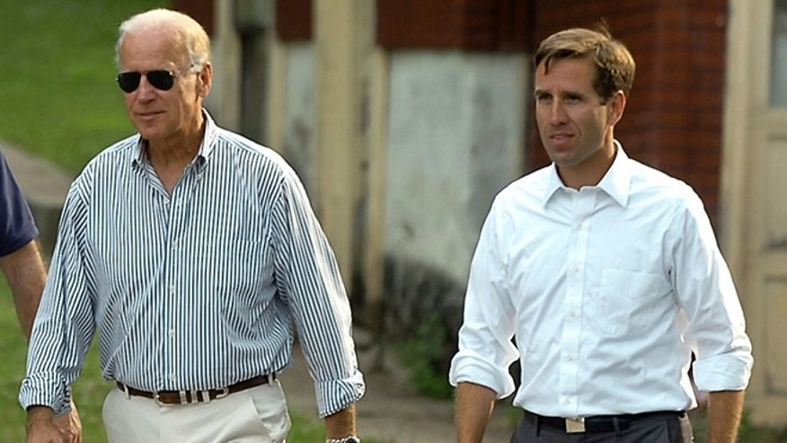 July 4, 2012: In this photo, Delaware Attorney General Beau Biden, right, takes a walk with his father,Vice President Joe Biden, to the Green Ridge Little Baseball Field in Scranton, Pa.
