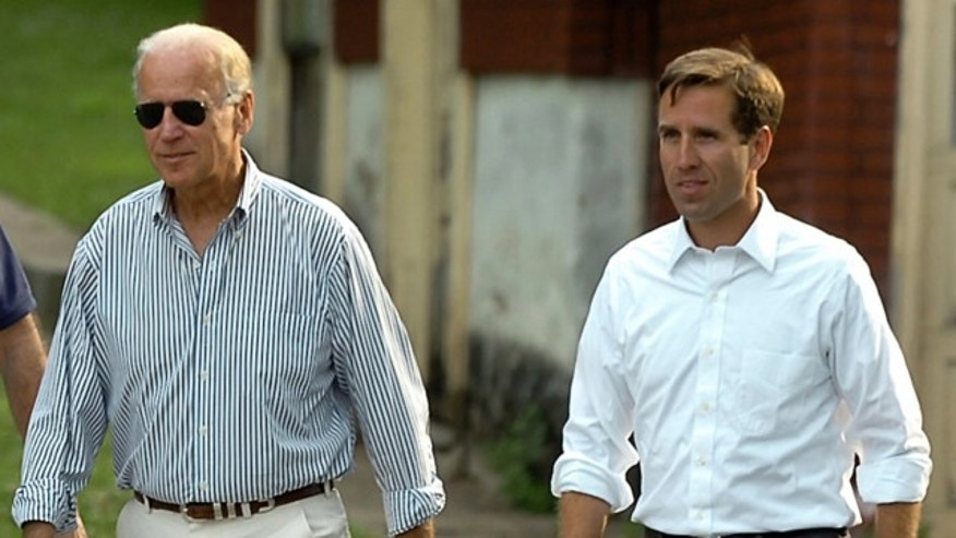 FILE: July 4, 2012: Delaware Attorney General Beau Biden, right, takes a walk with his father,Vice President Joe Biden, to the Green Ridge Little Baseball Field in Scranton, Pa.