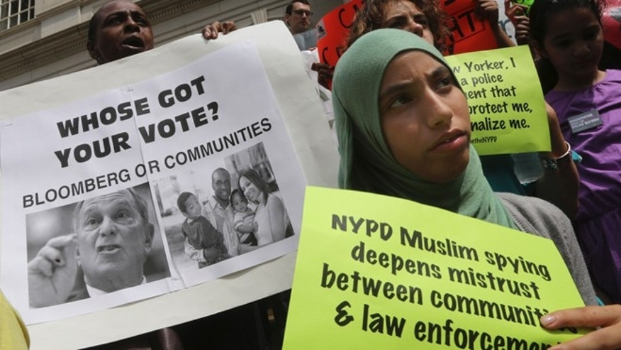 Aug 22, 2013: Supporters of the NYPD Oversight override vote demonstrate on the steps of City Hall in New York.