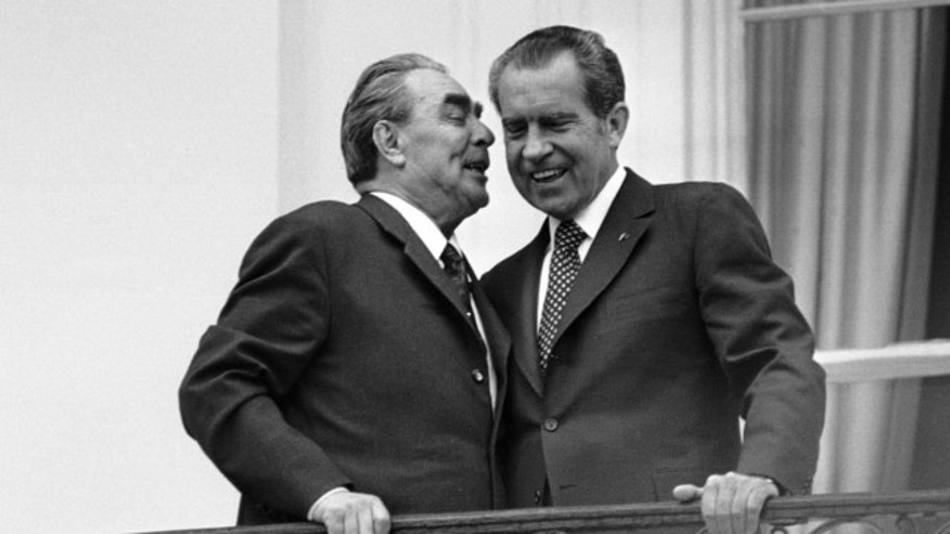 FILE: June 18,1973: Soviet leader Leonid I. Brezhnev, left, whispers in the ear of President Richard M. Nixon as the two leaders stand on a balcony at the White House in Washington.