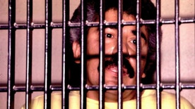 Mexican drug lord Rafael Caro Quintero is shown behind bars in this undated file photo.
