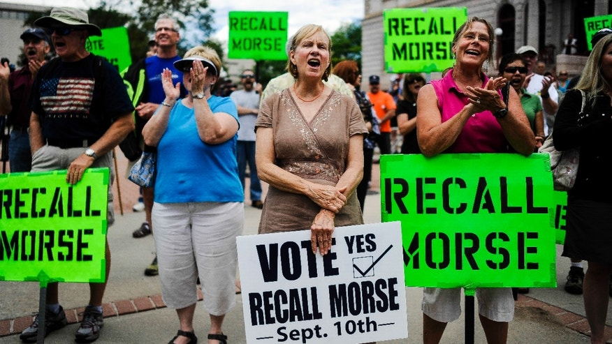 Janice Taylor, center, and other supporters of the recall election to oust Senate President John Morse rally outside the Pioneer Museum in Colorado Springs, Colo. Wednesday, Sept.  4, 2013.