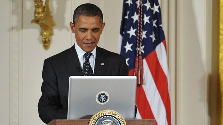 "US President Barack Obama sends a Twitter message at the start of a ""Twitter Town Hall"" in the White House earlier this month."