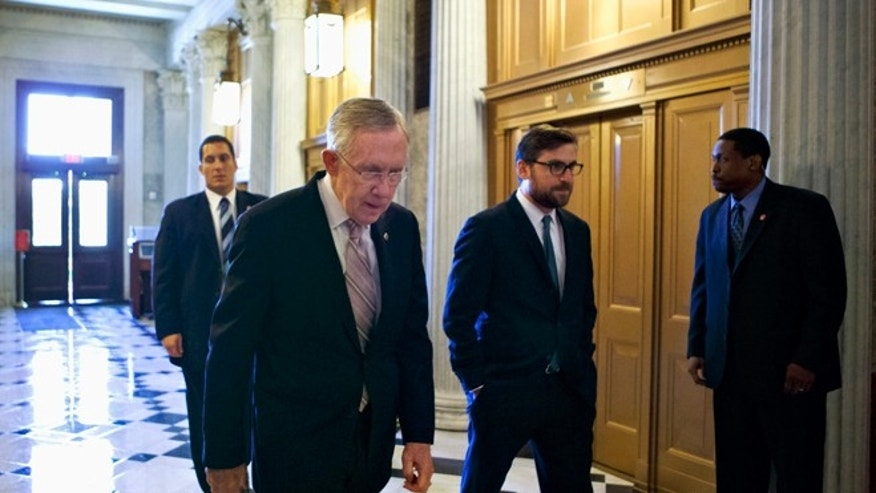 FILE: Friday, Sept. 6, 2013: Senate Majority Leader Harry Reid on his way to the Senate floor on Capitol Hill in Washington, D.C.