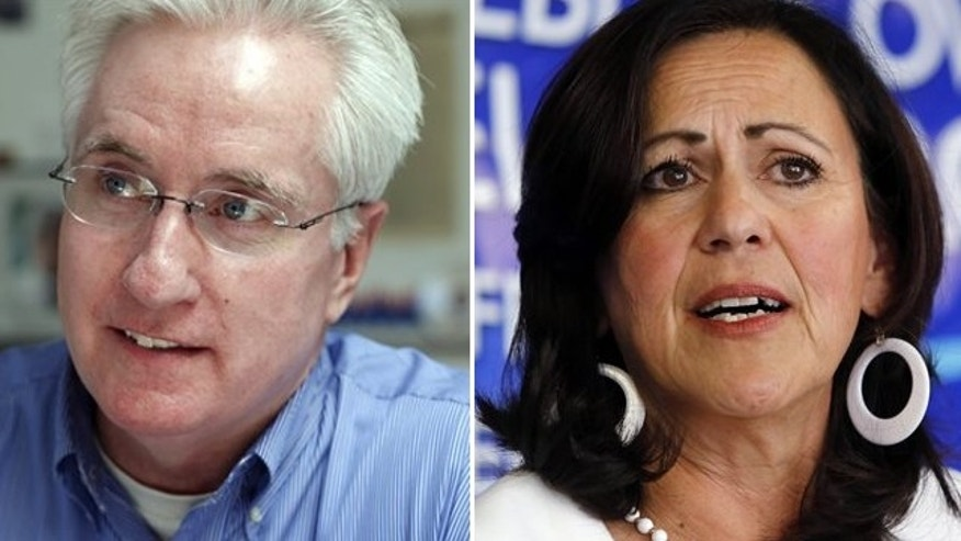 FILE:  This image shows Colorado Democratic State Senate President John Morse, left, and state Sen. Angela Giron, D-Pueblo.
