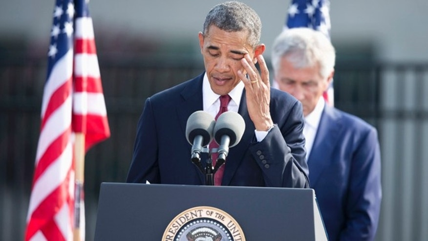Sept. 11, 2013: President Obama, with Defense Secretary Chuck Hagel, wipes his eye during a 9/11 remembrance ceremony at the Pentagon, in Arlington, Va.