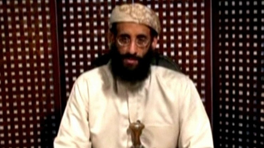Sept. 30, 2011: Anwar al-Awlaki, a U.S.-born cleric linked to Al Qaeda's Yemen-based wing, gives a religious lecture in an unknown location in this still image taken from video released by Intelwire.com.