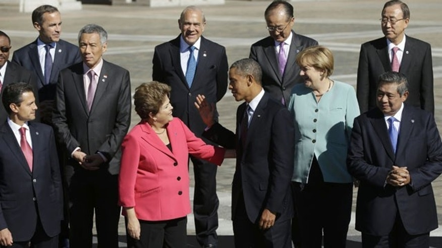 September 6, 2013: President Barack Obama, center, talks with Brazil's President Dilma Rousseff as he join with other leaders for the group photo at the G-20 summit at the Konstantin Palace in St. Petersburg, Russia. (AP Photo)