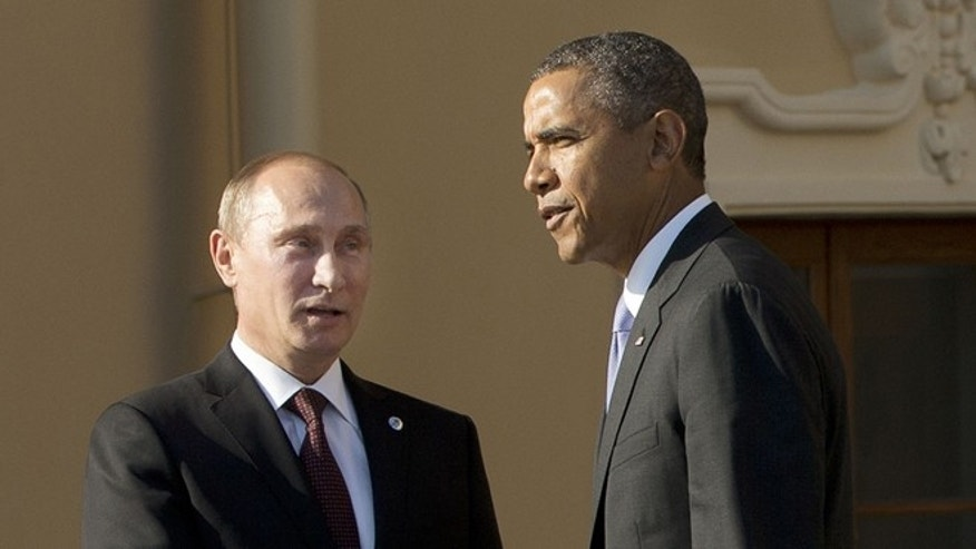 FILE: Sept. 5, 2013: President Obama shakes hands with Russian President Vladimir Putin during arrivals for the G-20 summit at the Konstantin Palace in St. Petersburg, Russia.