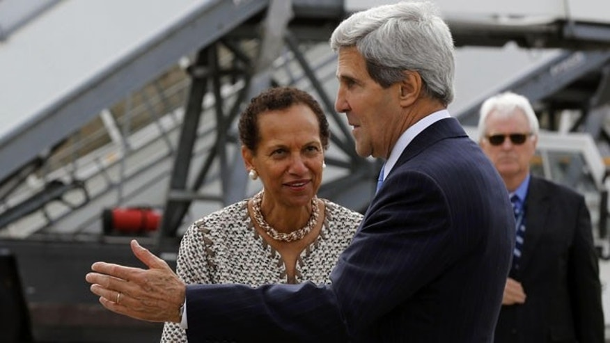 September 12, 2013: U.S. Secretary of State John Kerry, foreground, is welcomed by the U.S. Permanent Representative to the United Nations in Geneva Amb. Betty E. King, on arrival at Cointrin Airport, in Geneva prior to his meeting with Russian Foreign Minister Sergey Lavrov to discuss the ongoing problems in Syria. (AP Photo)
