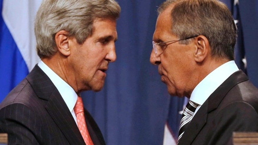 Sept. 14, 2013: U.S. Secretary of State John Kerry, left, and Russian Foreign Minister Sergei Lavrov, shake hands after making statements to the media following meetings regarding Syria, at a news conference in Geneva, Switzerland.