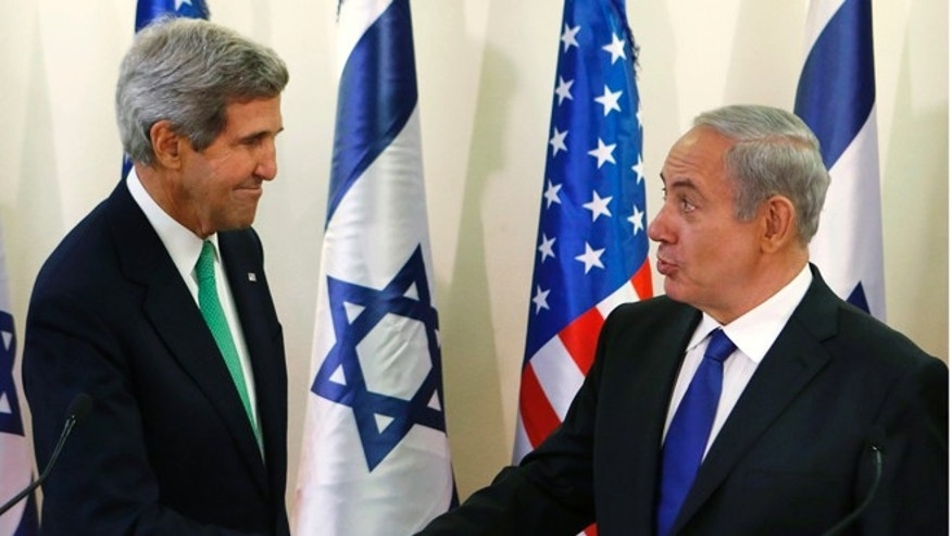 Sunday, Sept. 15, 2013: Secretary of State John Kerry, left, shakes hands with Israeli Prime Minister Benjamin Netanyahu, at his office in Jerusalem, Israel.