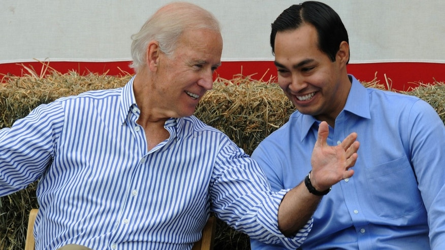 U.S. Vice President Joe Biden and San Antonio Mayor Julian Castro share a moment onstage at the 36th Annual Harkin Steak Fry on September 15, 2013 in Indianola, Iowa.