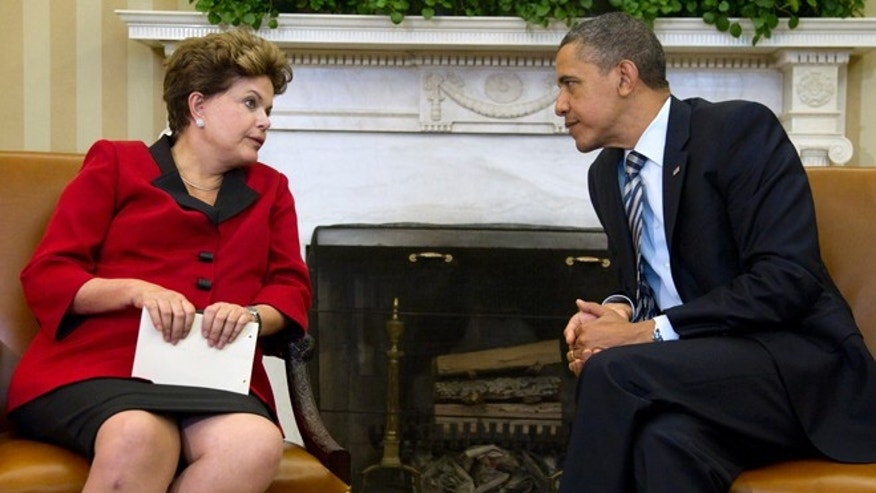 April 9, 2012: In this file photo, President Barack Obama, right, meets with Brazil's President Dilma Rousseff in the Oval Office of the White House in Washington.