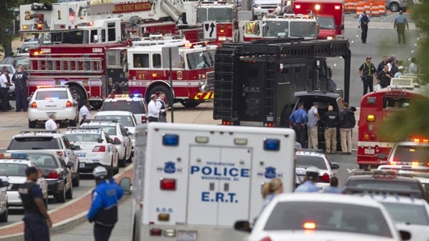September 16, 2013: A Emergency Response Team vehicle arrives to the scene where a gunman was reported at the Washington Navy Yard in Washington. (AP Photo)