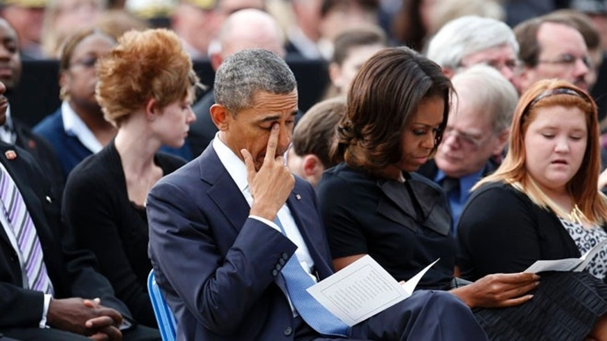 Sept. 22, 2013: President Obama wipes his eye as he is seated with first lady Michelle Obama at a memorial service for the victims of the Washington Navy Yard shooting at Marine Barracks Washington, D.C.