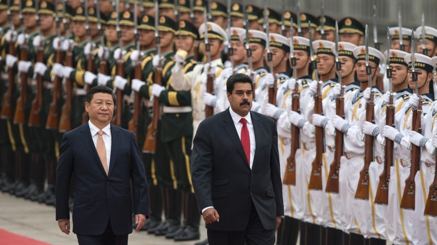 Presidents Xi Jinping and Nicolas Maduro during a ceremony outside the Great Hall of the People in Beijing, China, Sept. 22, 2013.