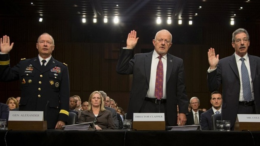 Sept. 26, 2013: National Security Agency Director General Keith Alexander, Director of National Intelligence James Clapper, and Deputy Attorney General James Cole are sworn in on Capitol Hill in Washington.