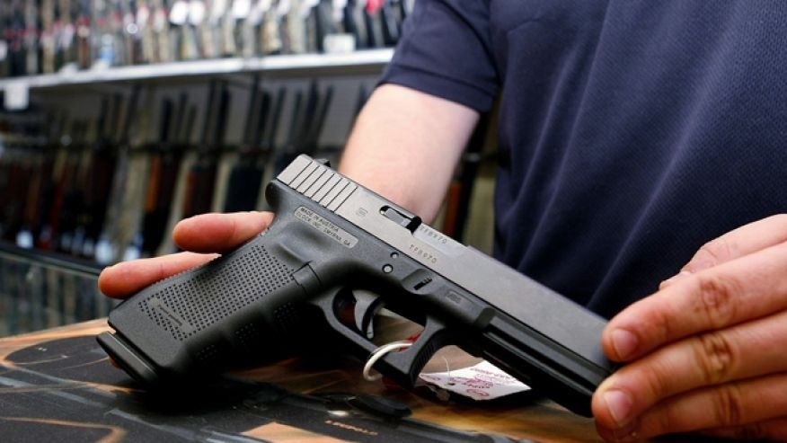 FILE: October 25, 2012: A Glock handgun available in a raffle promotion is shown at Adventures Outdoors in Smyrna, Ga.