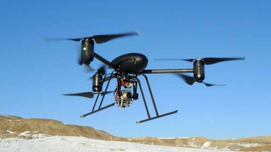 FILE: Jan. 8, 2009: This photo provided by the Mesa County, Colo., Sheriff's Department shows a small Draganflyer X6 drone during a test flight in Mesa County, Colo., with a Forward Looking Infer Red payload.
