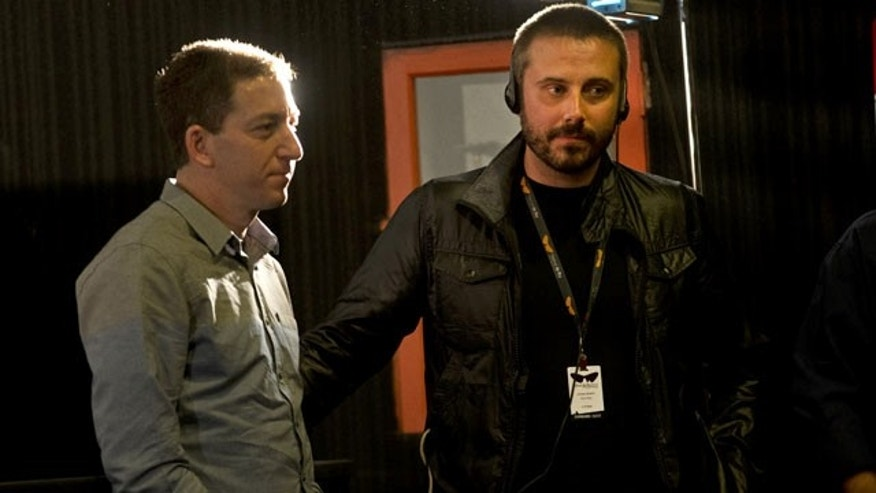 "September 28, 2013: American journalist Jeremy Scahill, right, and Glenn Greenwald wait for the beginning of a panel following the screening of the ""Dirty Wars"" documentary, based on a book of the same name by Scahill, at the Rio Film Festival in Rio de Janeiro, Brazil. (AP Photo)"