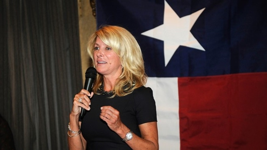 FILE: July 25, 2013: Texas State Sen. Wendy Davis, famous for her 12-hour filibuster attempt against an anti-abortion rights bill, speaks at a fundraiser in Washington, D.C.