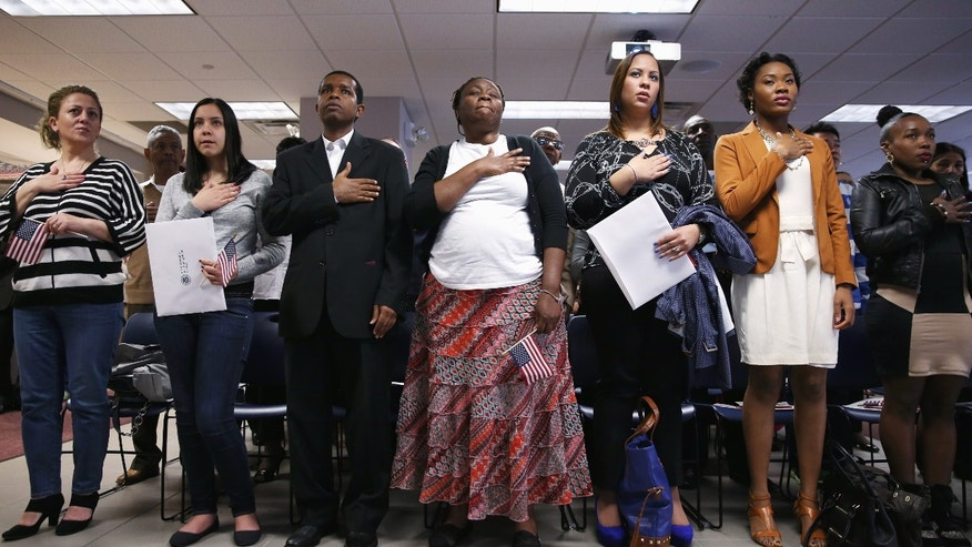 A naturalization ceremony at the U.S. Citizenship and Immigration Services (USCIS), office on May 17, 2013 in New York City.