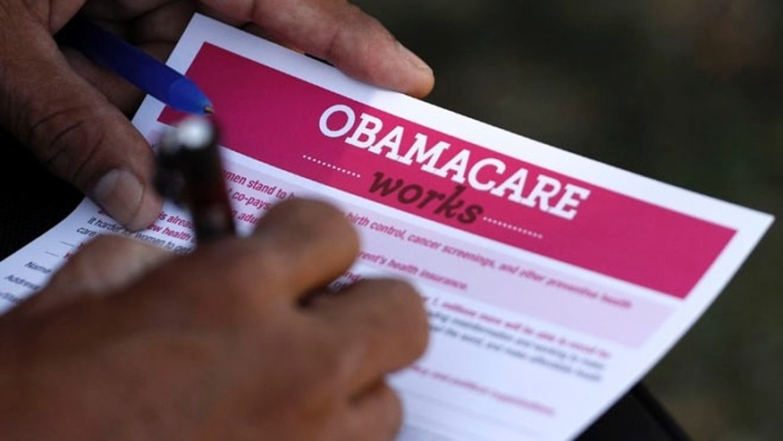 FILE: September 28, 2013. A man fills out an information card during an Affordable Care Act outreach event hosted by Planned Parenthood for the Latino community in Los Angeles, Calif.