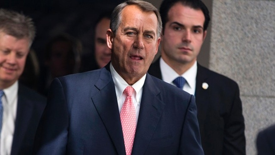 FILE: Sept. 30, 2013: House Speaker John Boehner of Ohio walks to a House Republican Conference meeting to discuss the ongoing budget fight.