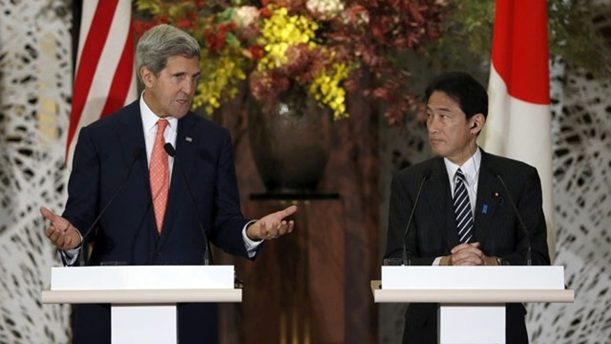 October 3, 2013: U.S. Secretary of State John Kerry and Japan's Foreign Minister Fumio Kishida attend their joint news conference with U.S. Secretary of Defense Chuck Hagel and Japan's Defense Minister Itsunori Onodera (not pictured) after the Japan-U.S. security talks in Tokyo. (AP Photo)