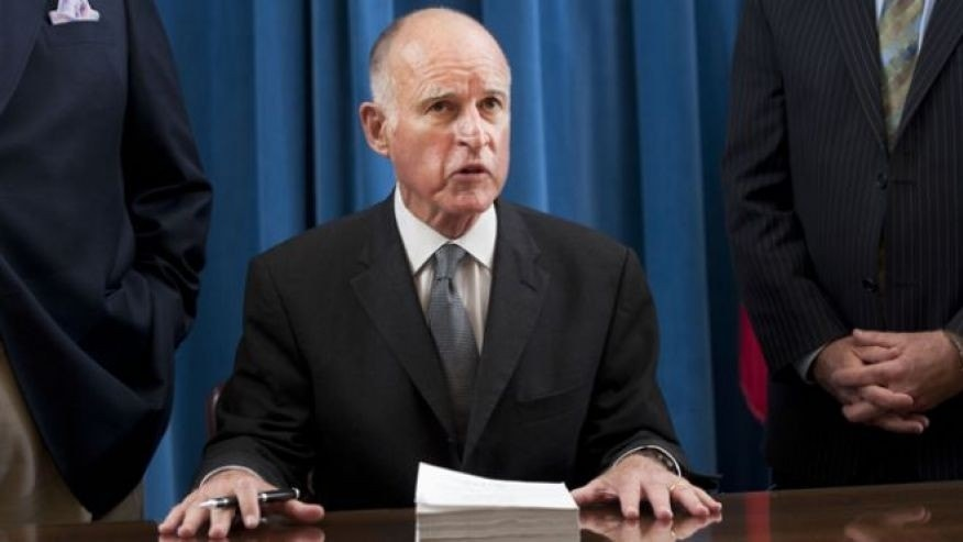 FILE: June 30, 2011: California Gov. Jerry Brown signs the state budget.
