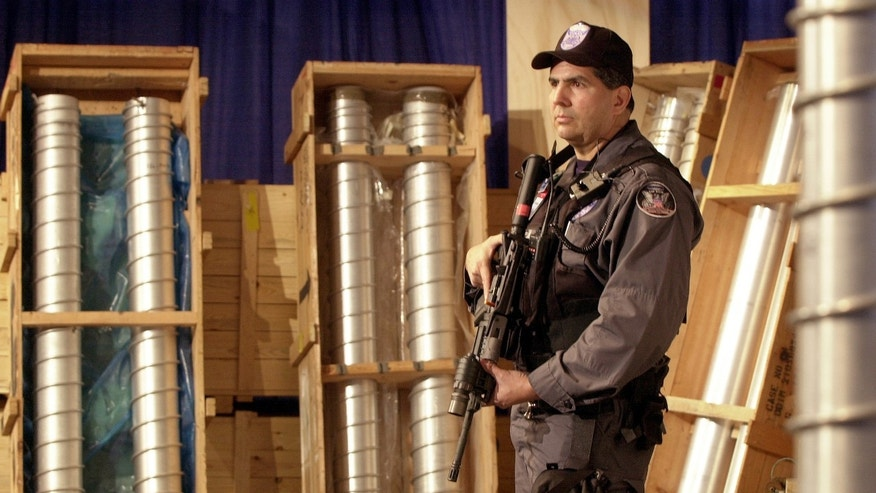 Security team member Pat Galardo guards components of the nuclear weapons program at the Y-12 National Security Complex in Oak Ridge, Tennessee, March 15, 2004.